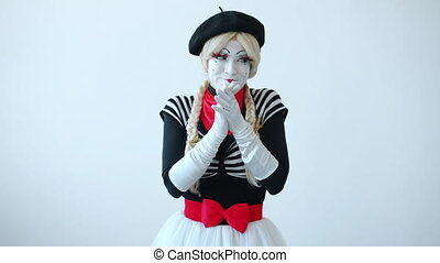 Portrait of evil young woman in costume mime rubbing hands making bad plan anticipating wrong-doing looking at camera with sly face. People and character concept.