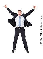 Portrait of excited businessman