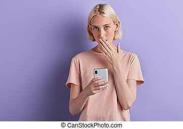 unexpected, impressed woman closing, covering her mouth with palm