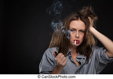 Portrait of exhausted female holding cigarette. bad looking woman smoking cigarette on black background