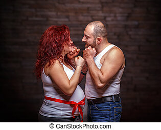 Portrait of expecting couple