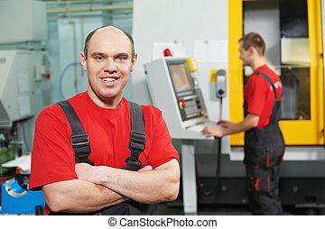 Portrait of experienced industrial worker