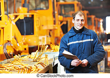 Portrait of experienced industrial engineer