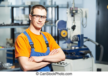 Portrait of experienced industrial worker - Portrait of...
