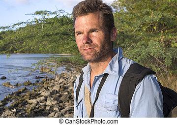 Portrait of explorer - Handsome scruffy Caucasian man gazes...