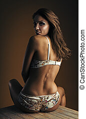 portrait of exquisite woman in stylish lingerie