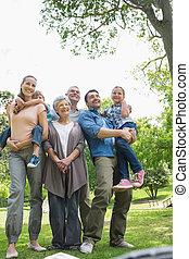 Portrait of extended family at park - Portrait of cheerful...