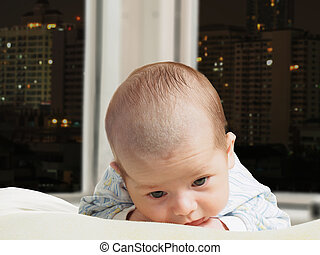 Portrait of face funny caucasian newborn toddler baby boy