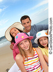 Portrait of family at the beach