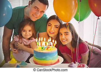 Portrait of family celebrating birthday