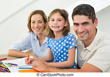 Portrait of family coloring at home