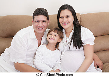 Portrait of family expecting new baby to come