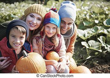 Portrait of family in pumpkin field