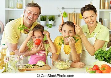 family in the kitchen preparing