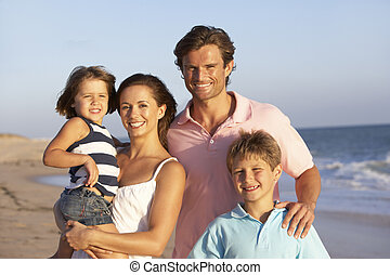 Portrait Of Family On Beach Holiday