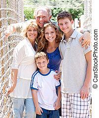 portrait of family on hanging bridge