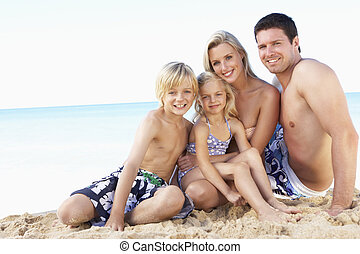 Portrait Of Family On Summer Beach Holiday