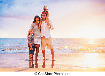 Portrait of Family on the Beach at Sunset