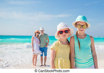 Portrait of family on the beach. Family summer vacation