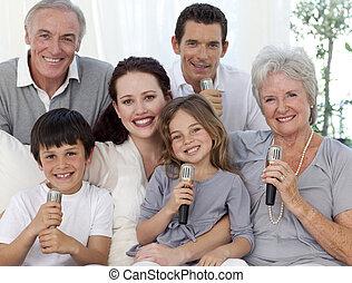 Portrait of family singing in living-room