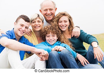 Portrait of family sitting on beach lawn