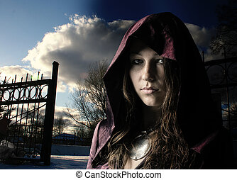 young girl in a dress with a hood