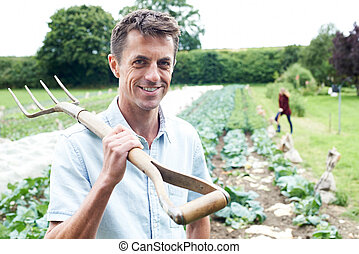 Portrait Of Farm Workers In Organic Field