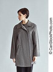 Portrait of fashion beautiful woman on gray background