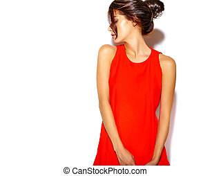 Portrait of fashion cute young girl model in a red dress on a white background