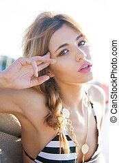 fashion model posing on the beach