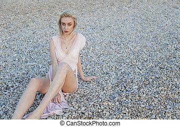 Portrait of fashionable women on the beach of the sea coast