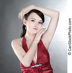 portrait of fashionable young woman in a red dress.