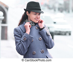 portrait of fashionable young woman on city background