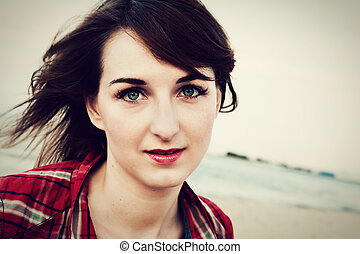 Portrait of fashionable young woman on the beach