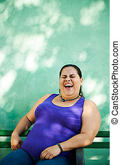Portrait of fat woman looking at camera and smiling - ...