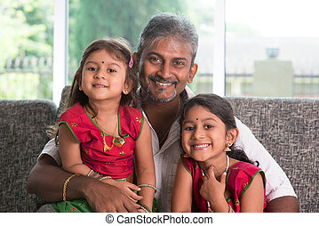 Portrait of father and daughters