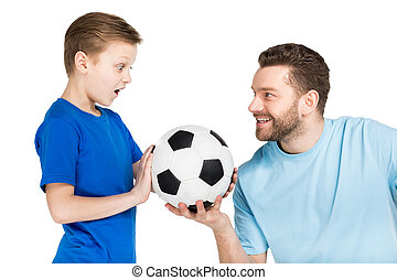 Portrait of father and son playing soccer isolated on white