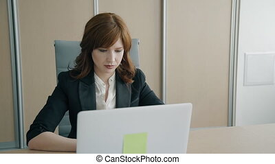 Portrait of female boss working in the office.
