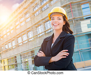 Portrait of Female Contractor Wearing Hard Hat at Construction Site