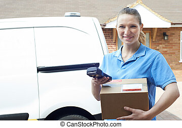 Portrait Of Female Courier With Van Delivering Package To...