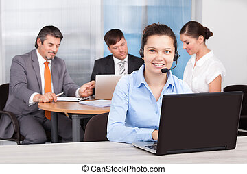Female Customer Care Executive Working At Office - Portrait ...