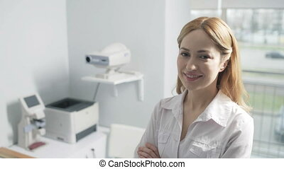 Portrait of female doctor smiling at camera - Qualified...