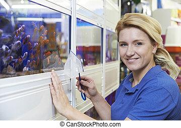 Portrait Of Female Employee In Pet Store