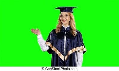 Portrait of female graduate student. Green screen - Portrait...