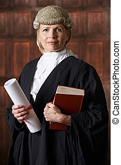 Portrait Of Female Lawyer In Court Holding Brief And Book