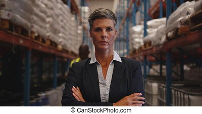 Portrait of female manager in a warehouse 4k