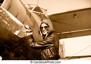 Portrait of female pilot  with plane propeller