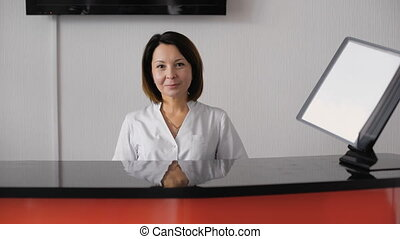 Portrait of female receptionist - Portrait of female...