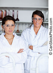 Portrait of female science students posing
