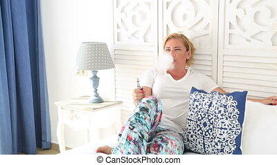 Portrait of female smoker with electronic cigarette